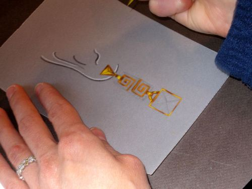 Photo of a gold earring rendering in process (#1)