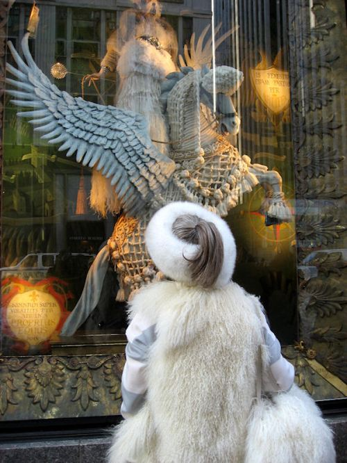 Photo of fur-bedecked lady looking at the windows at Bergdorf Goodman's taken by Joana Miranda