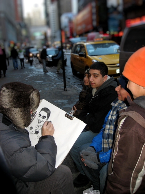Photo of a NY street artist working on a caricature, taken by Joana Miranda