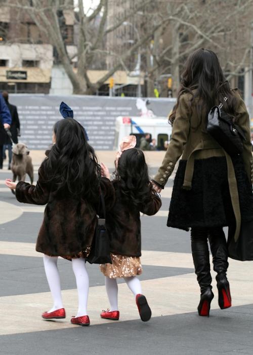 Photo of young Asian family leaving Fashion Week - taken by Joana Miranda