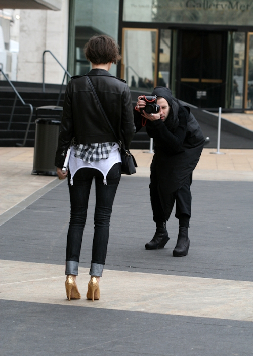Photo of wild outfitted photographer taking photo of model with gold glitter high heels - taken by Joana Miranda