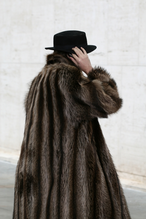 Man in a fur coat talking on a cell phone as he arrives at Lincoln Center - Photo taken by Joana Miranda