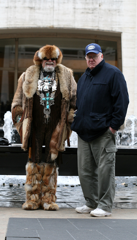 Photo of fur bedecked man with very pedestrian-dressed friend - taken by Joana Miranda
