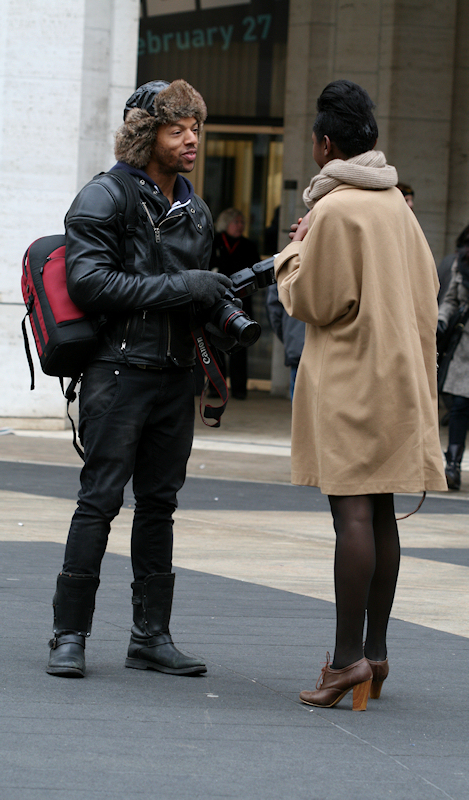 Photo of photographer talking with model outside Mercedez Benz tent at 2011 winter Fashion Week - taken by Joana Miranda
