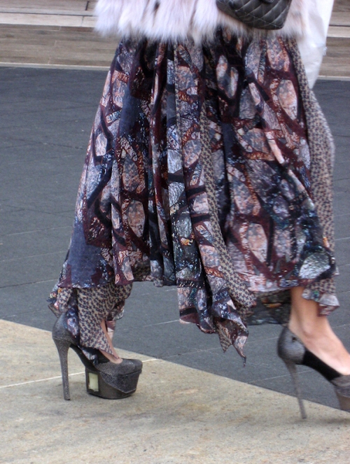 Close up of very high-heeled platform shoes - taken at 2011 Fashion Week by Joana Miranda