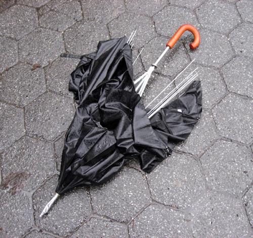 Photo of broken, discarded umbrella in NY city, taken by Joana Miranda