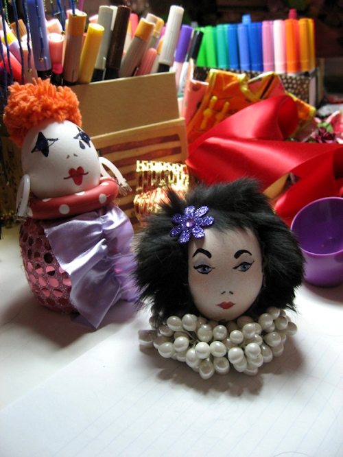 Photo of clown and glamorous fur-head egg lady decorated by Joana Miranda
