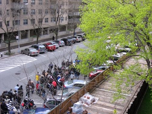 Good Friday procession making its way down 97th Street - photo taken by Joana Miranda