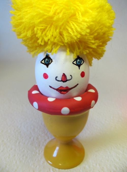 Photo of cute clown egg with yellow pom-pom hair, taken by Joana Miranda