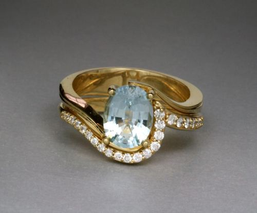 Photo of topaz and yellow gold engagement ring and matching diamond band, designed by Joana Miranda