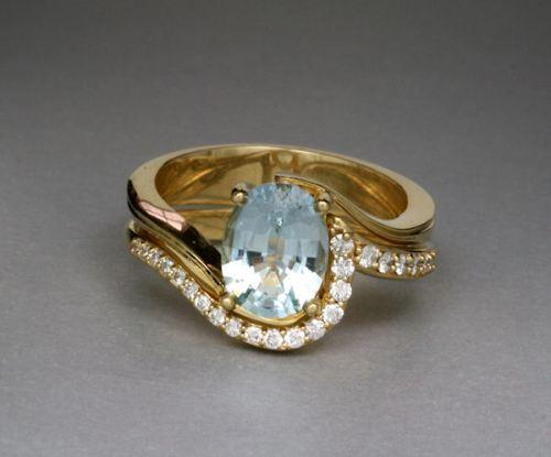 Photo of topaz and yellow gold engagement ring and matching diamond band, designed by Joana Miranda
