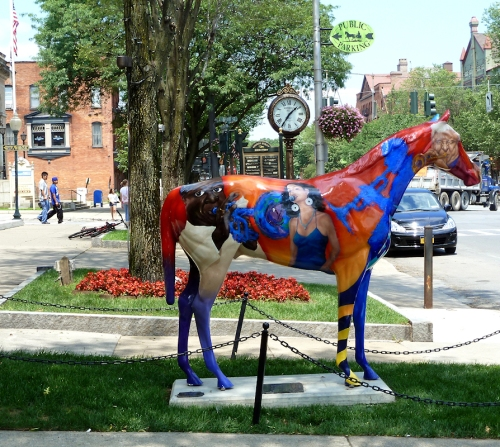 "Photo of painted ""Jazz"" blue and red horse in downtown Saratoga Springs, NY, taken by Joana Miranda"