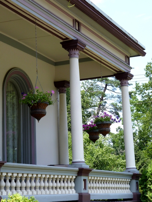 Photo of flower pots on Victorian porch in Saratoga Springs, NY, taken by Joana Miranda