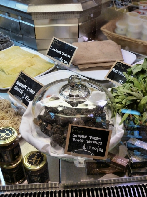 Photo of black truffles for sale at Eataly, taken by Joana Miranda