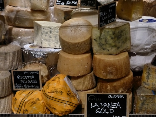 Photo of assorted cheeses for sale at Eataly, taken by Joana Miranda