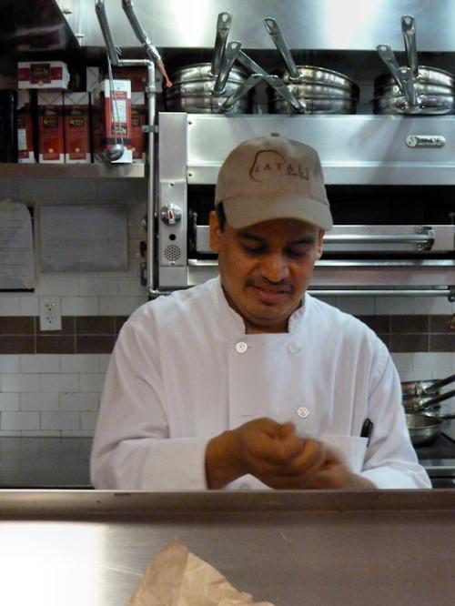 Photo of hispanic chef working at pasta counter at Eataly, taken by Joana Miranda