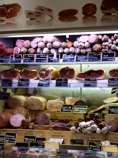Photo of cured meats and sausages at Eataly, taken by Joana Miranda