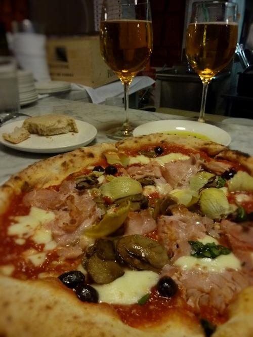 Photo of pizza and Italian beer, taken by Joana Miranda