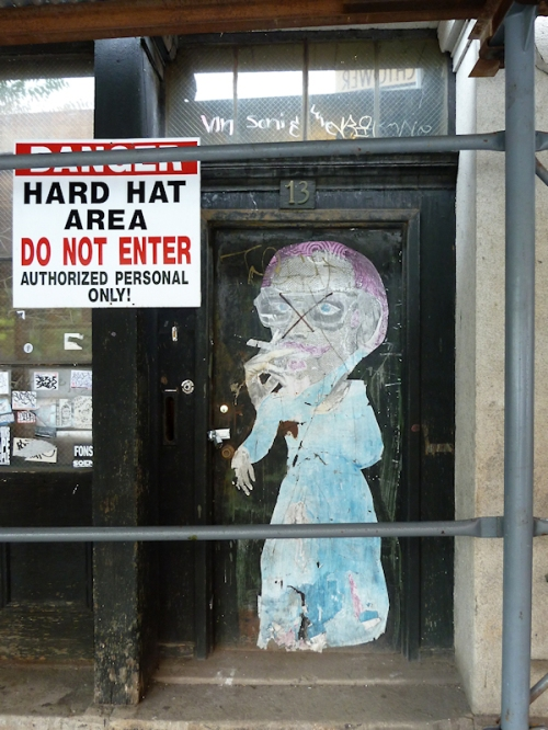 Photo of collage graffiti on door in Brooklyn, taken by Joana Miranda