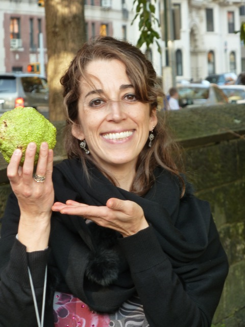 Photo of Joana with Osage Orange fruit, taken by Tom Cathey