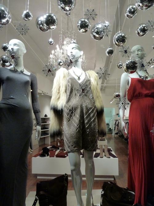 Photo of festive clothing store window on Broadway, taken by Joana Miranda