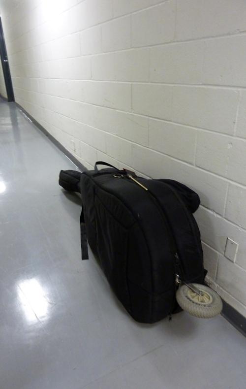 Photo of double bass with transportation wheel, taken by Joana Miranda