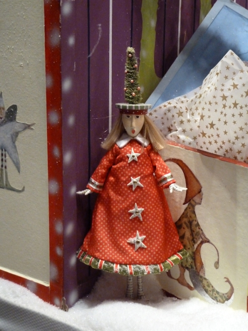 Photo of Christmas doll with red dress and tree hat, taken by Joana Miranda