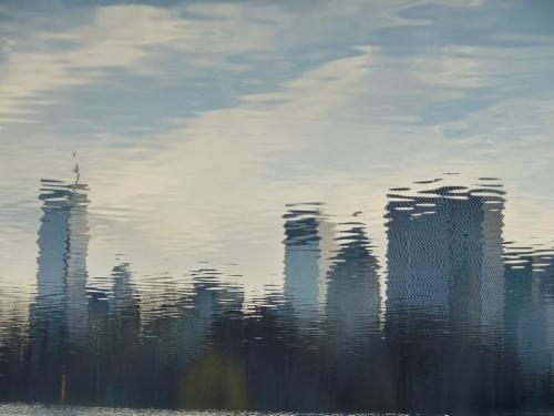 Photo of NY City skyline reflected in the water, taken by Joana Miranda