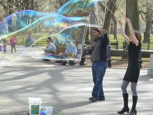 Photo of Bubble Man and friend making bubbles, taken by Tom Cathey