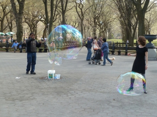 Photo of man blowing bubbles in Central Park, taken by Tom Cathey
