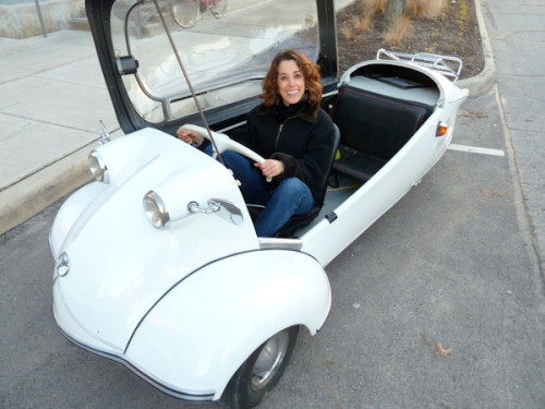 Photo of Joana in white German vintage automobile, taken by Joana Miranda