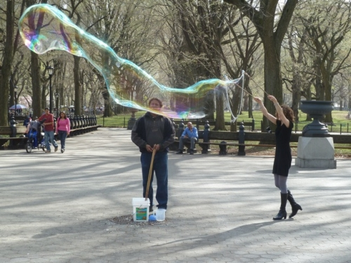 Joana makes a big bubble in Central park, photo taken by Tom Cathey