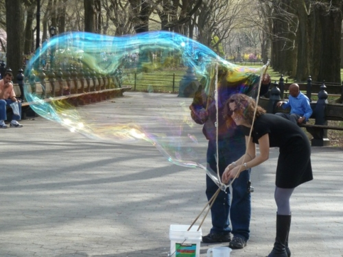 Photo of Joana getting into a giant bubble in Central Park, taken by Tom Cathey