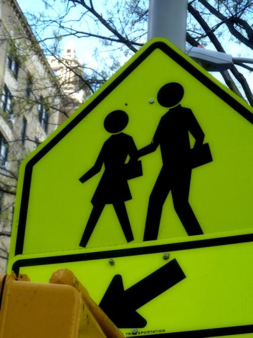 Photo of a neon yellow street crossing sign, taken by Joana Miranda