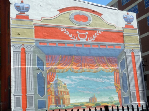 Photo of stage mural on wall near Dupont Circle, Washington, D.C. taken by Joana Miranda