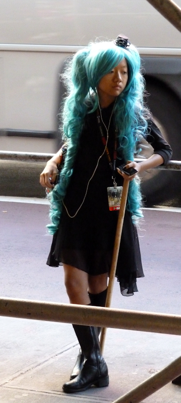 Photo of Asian woman with teal-colored hair in Midtown Manhattan, taken by Joana Miranda