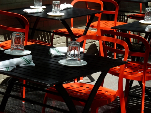 Photo of orange and black cafe table settings as seen on Upper West Side, taken by Joana Miranda