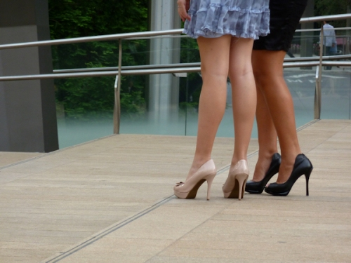 Photo of two women in mini skirts with heels and bare legs, taken by Joana Miranda