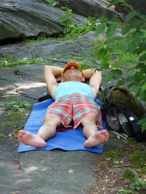Photo of man in madras shorts asleep on a rock, taken by Joana Miranda