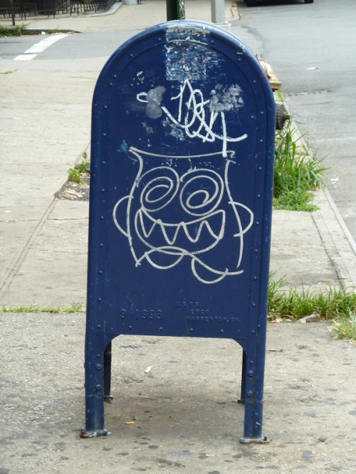 "Photo of US mailbox ""decorated"" with graffiti, taken by Joana Miranda"