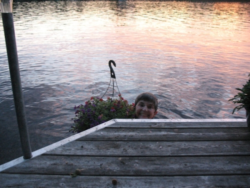 Photo of my mom swimming and watering one of her plants at the same time, taken by my sister, Marta.
