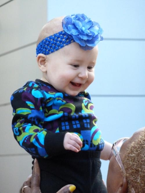 Photo of baby with flower head band seen at 2012 Mercedez Benz Fashion Week - taken by Joana Miranda