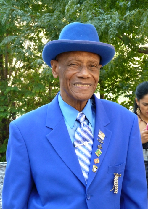 Photo of dapper African American man dressed in head-to-toe blue at the 2012 Mercedes Benz Fashion Week - photo by Joana Miranda