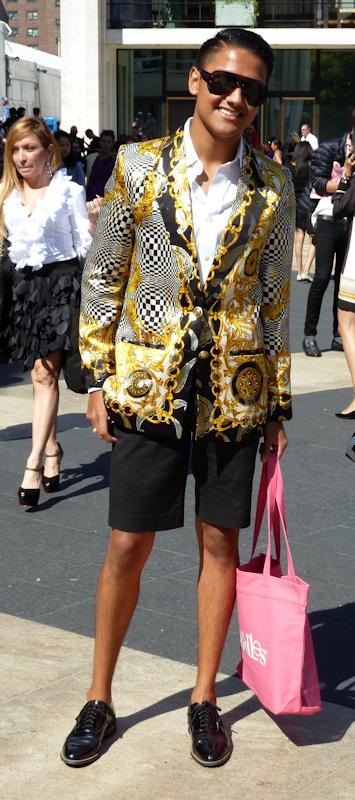 Photo of young man wearing black and gold silk smoking jacket with black shorts - seen at 2012 Mercedes Benz Fashion Week.  Photo by Joana Miranda