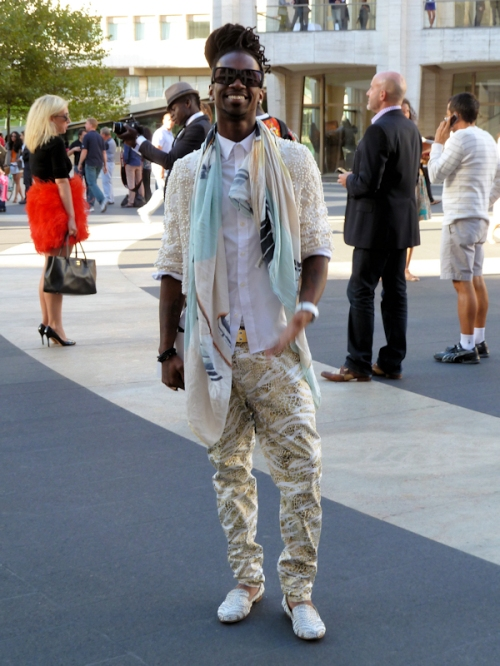 Photo of young happy African American man dressed to the nines at Mercedes Benz Fashion Week - photo taken by Joana Miranda