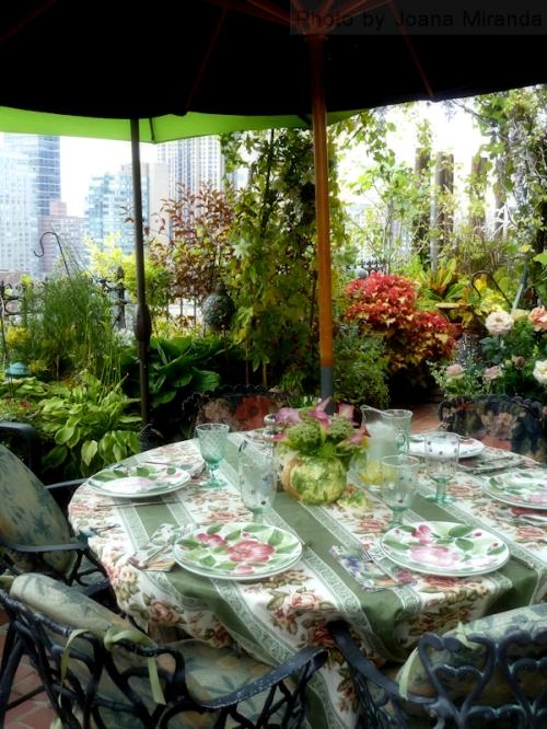 Photo of serene table setting on rooftop terrace, taken by Joana Miranda