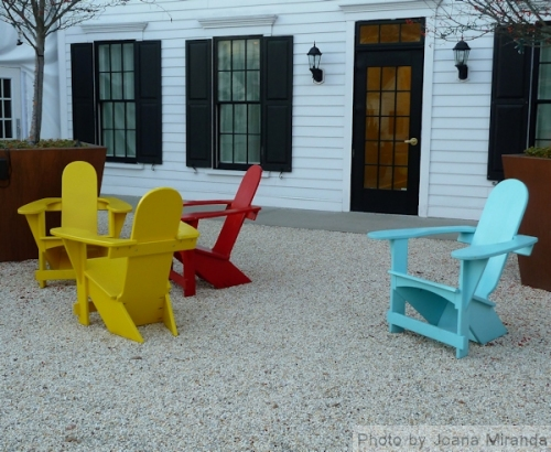 Photo of colorful Adirondack chairs taken by Joana Miranda