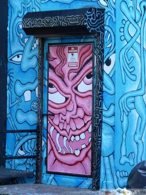 Photo of graffiti painted doorway at 5Pointz, taken by Joana Miranda