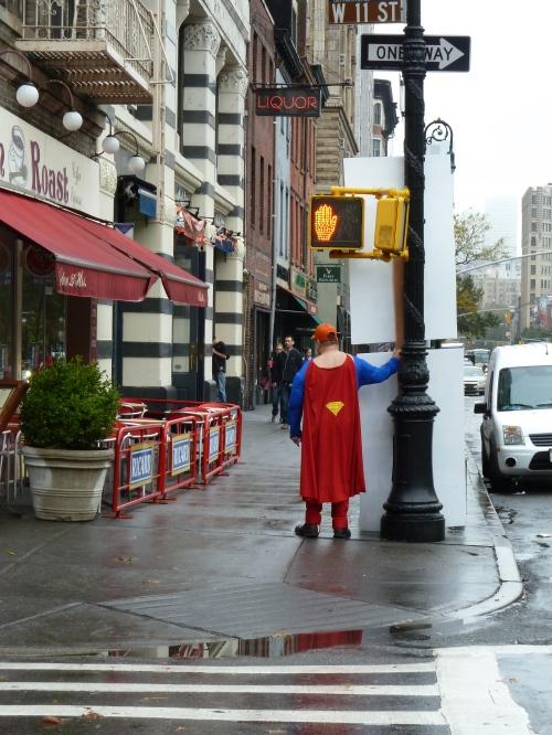 Photo of man in a superhero cape on the streets of New York, taken by Joana Miranda