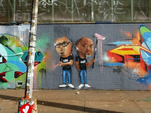 Photo of graffiti depicting two painters, taken at 5Pointz by Joana Miranda